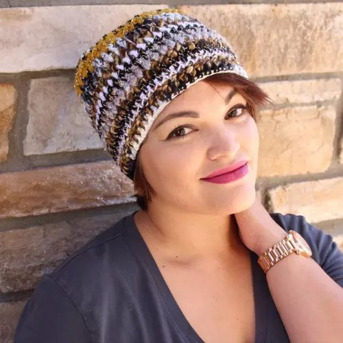 For this beanie, I used all black, white, gold and striped yarns. (Dania Zarate, model)