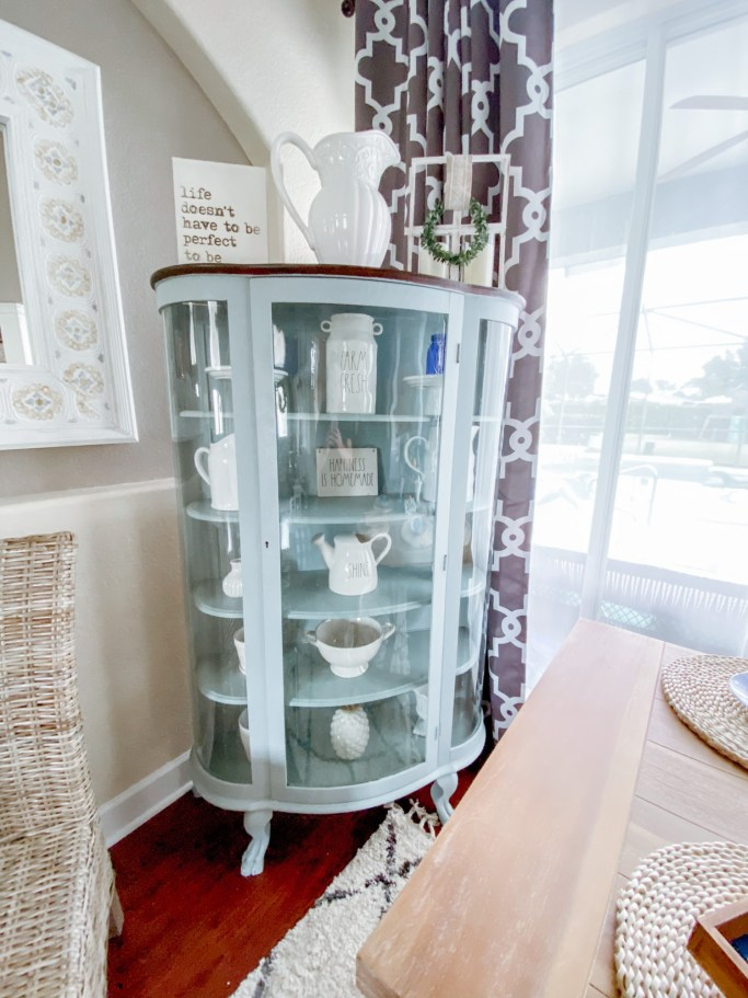 Furniture Cabinet Makeover with just paint and one afternoon. #paintedfurniture #cabinetmakeover #curiocabinet #hutch #paintedhutch