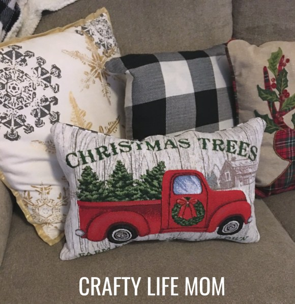 Make your own Christmas DIY Placemat pillows out of inexpensive placemats. They are an easy and inexpensive way to add a touch of Christmas to any room! They also make great gifts for just a few bucks! Genius!