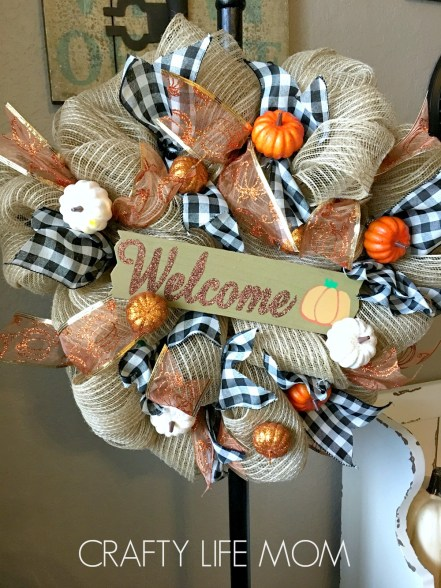 DIY Burlap Mesh Wreath tutorial. Learn to make a wreath with these simple steps plus download a free supplies list that includes materials and supplies from the dollar store.
