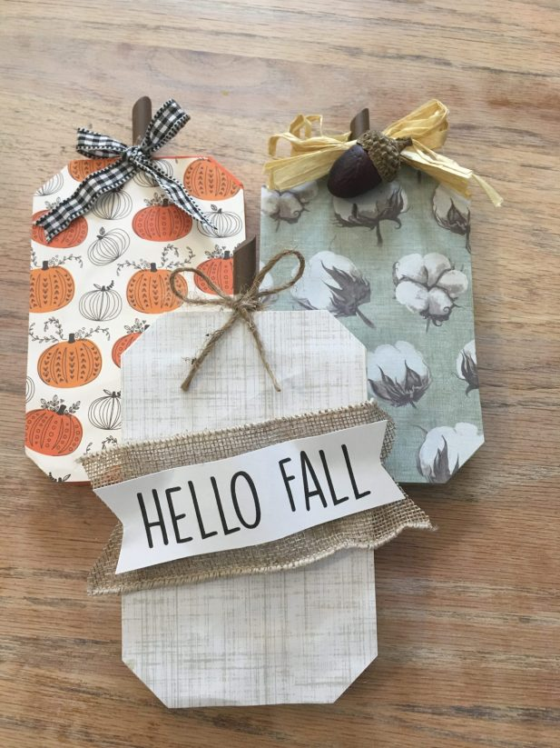Create this adorable wood pumpkin trio using items mostly form the dollar and your favorite craft store. Plus get the FREE SVG cut file to duplicate the Hello Fall banner tag. A simple DIY to jumpstart the Fall season of crafting.