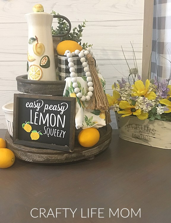Create this Easy Peasy Lemon Squeezy sign using Dollar Tree items with this free SVG cut file design with your Cricut or Silhouette machine. You can download Free Lemon SVG cut file from the Resource Library and create your own Lemon Decor sign.
