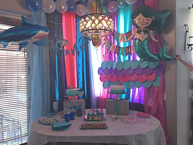 Mermaid Shark Party decorations and ideas for a joint boy and girl birthday party. Get the full ist of where to get easy to make and create decorations.