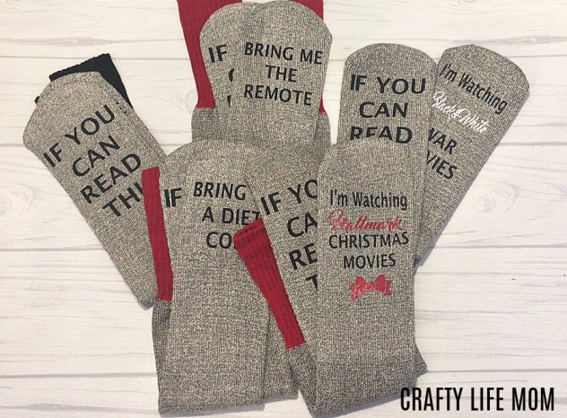 Learn how to create and DIY Funny Socks with words using your Cricut or Silhouette machine and heat transfer vinyl. This tutorial shows you how to create cute custom socks as gifts or for yourself. These socks are super cute and fun to create using left over heat transfer vinyl.  #Sockswithwordsdiy #giftsyoucanmake