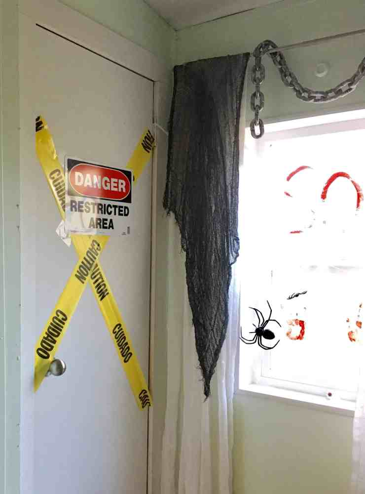 halloween bathroom decor. I added metal signs from the hardware store that say  No Trespassing and Caution they only cost a couple dollars each Halloween Bathroom Decor Crafty Little Gnome