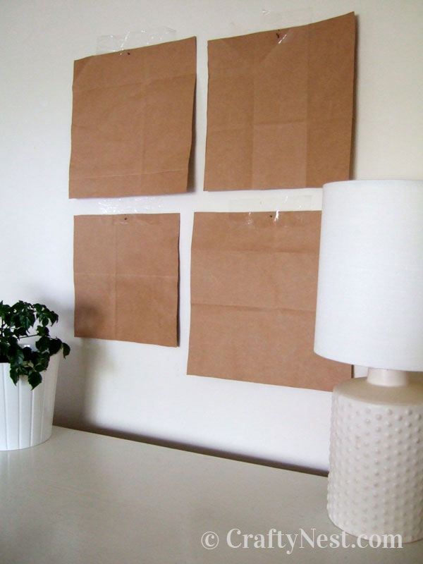 Pieces of brown paper taped to the wall, photo