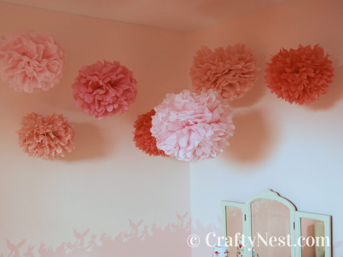 Tissue-paper flowers hanging from the ceiling, photo