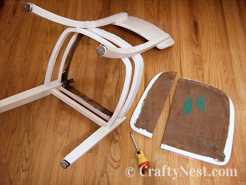 Disassembled chair with broken seat, photo