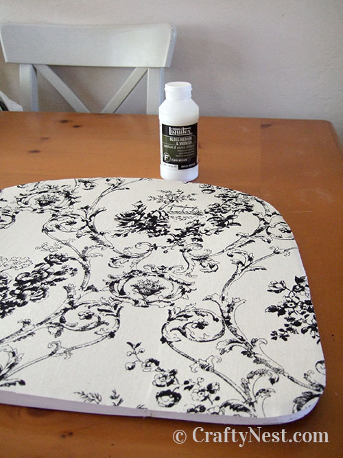 Apply artist's medium and fabric to the seat, photo