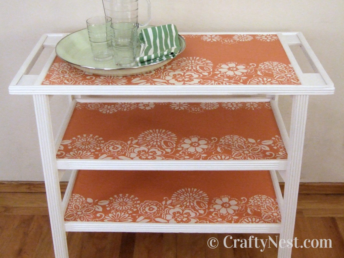 White cart with orange and white wallpapered shelves, photo