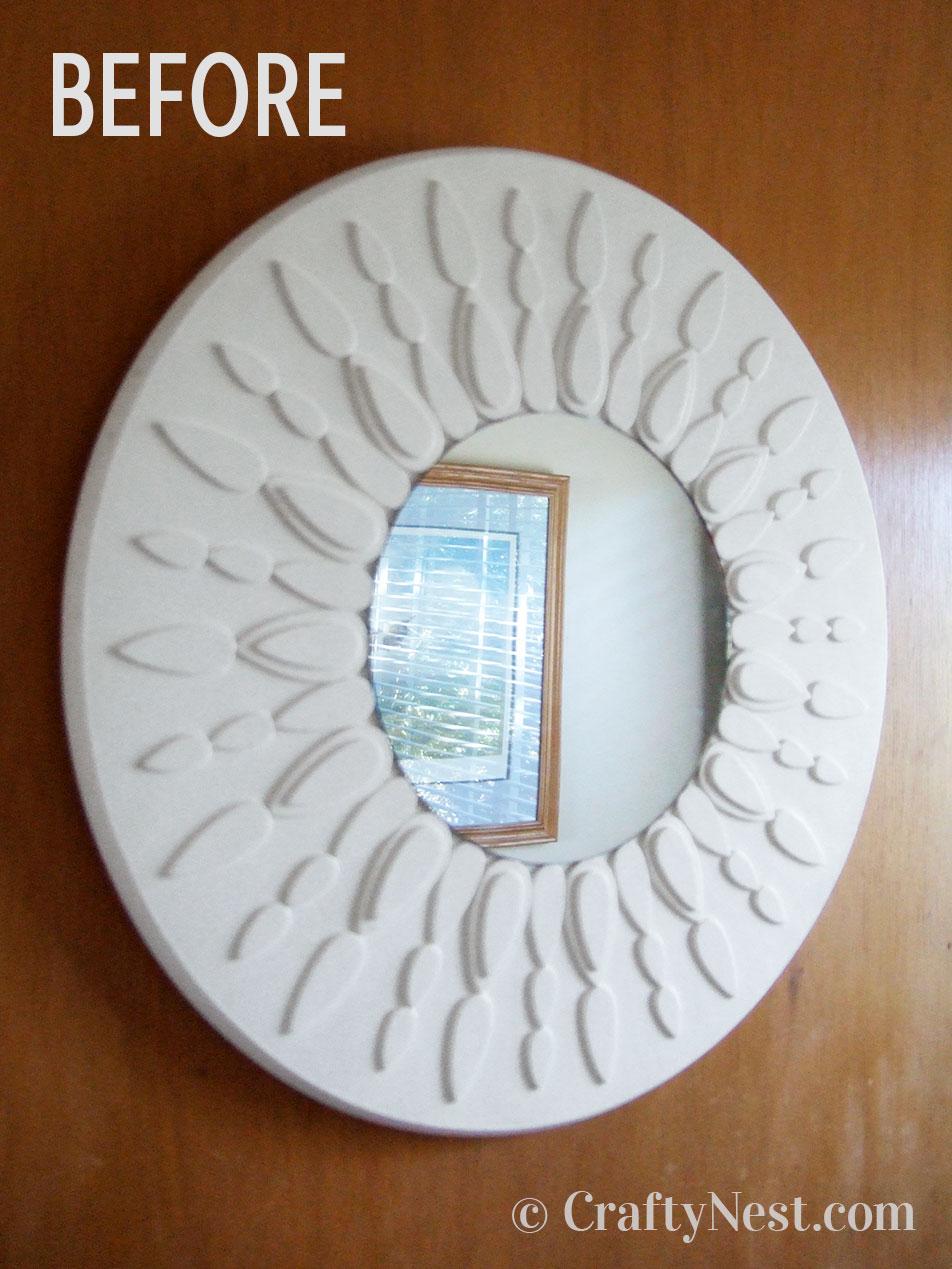 White sunburst mirror, before photo