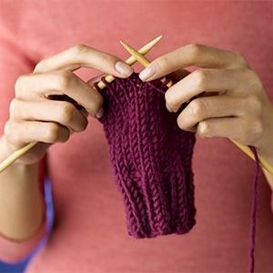 Closeup of hands knitting, photo