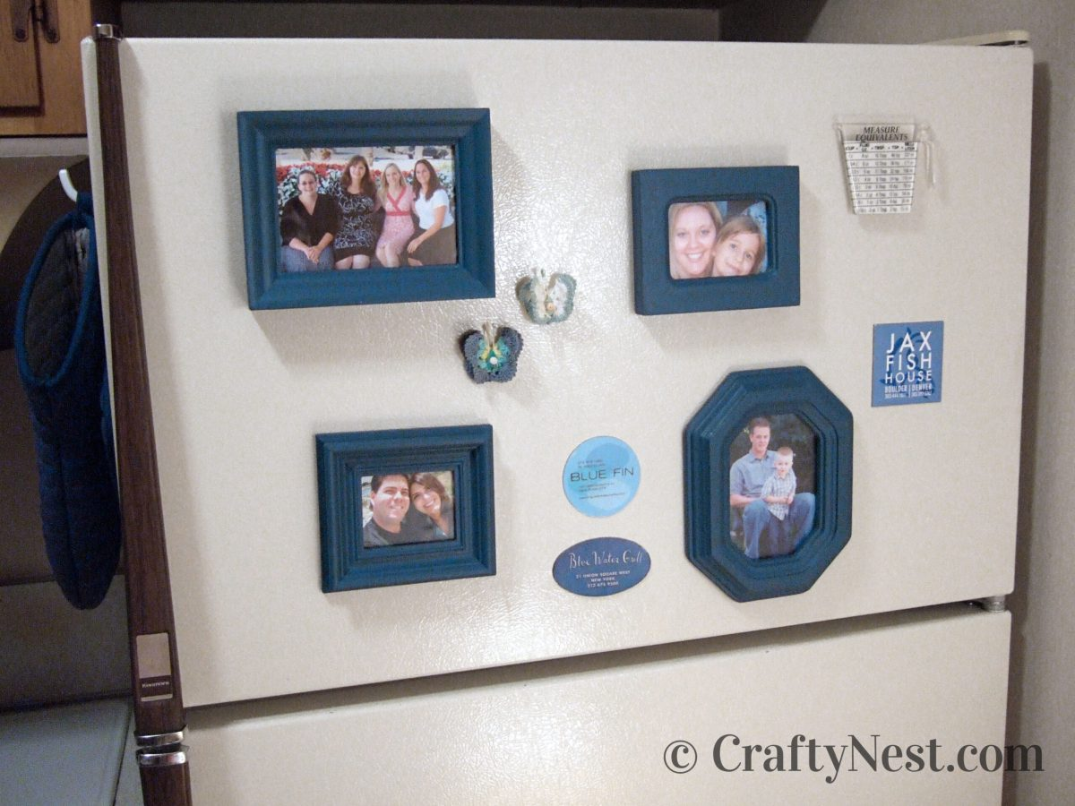 Blue magnetic frames stuck on a fridge, photo