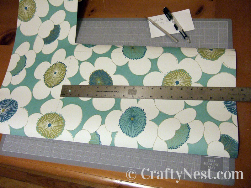 Cutting the decorative paper, photo