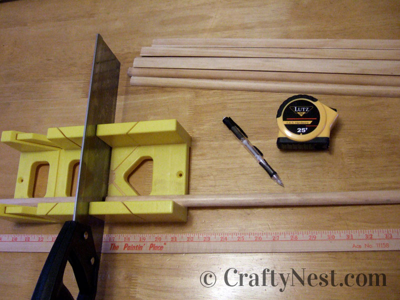 Cutting the wood with a miter box and pull saw, photo