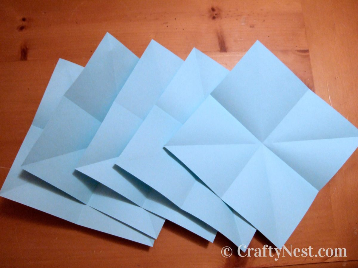 Folded squares of paper, photo