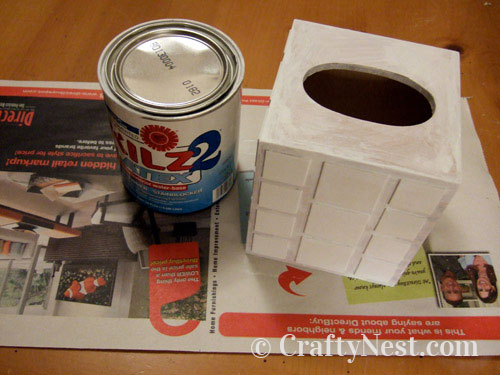 Tissue box painted with primer, photo