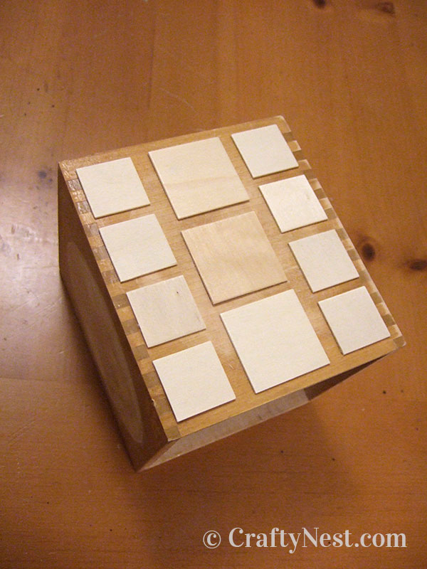 Wood squares placed on the box, photo