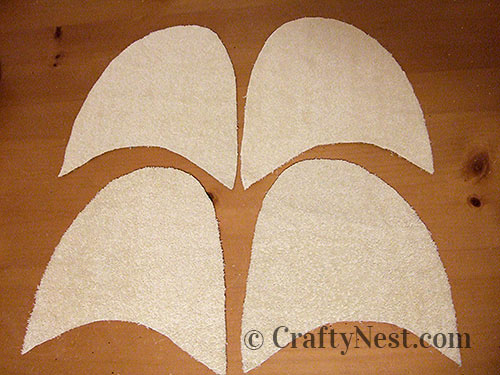 Four tops of slippers cut out, photo