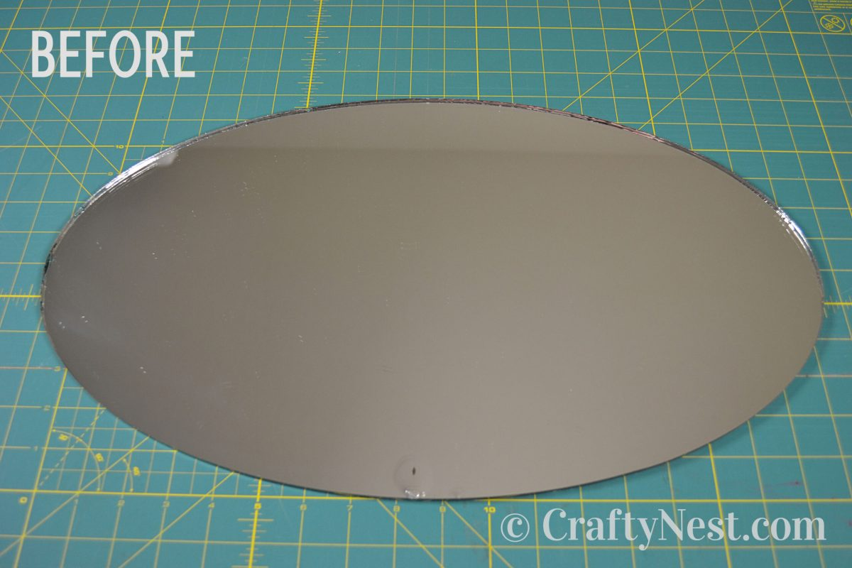 Unframed oval mirro, before photo
