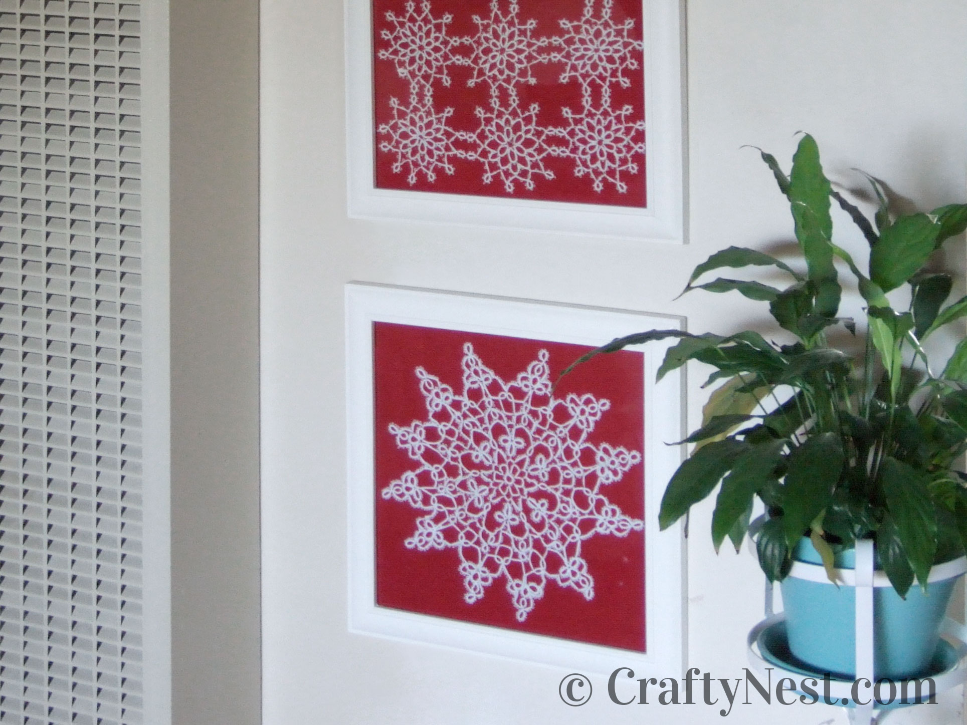 Three framed doilies with red backgrounds, photo