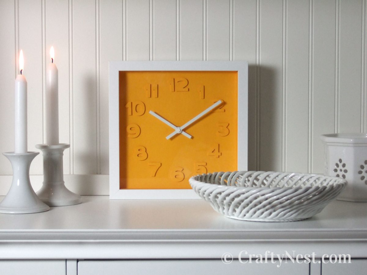 Square embossed-numbers clock, photo