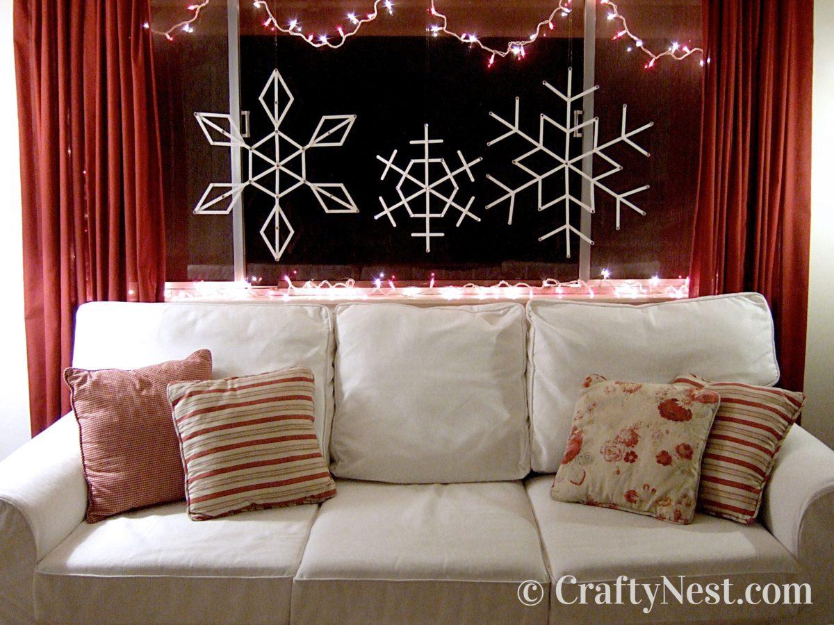 White craft-stick snowflakes in window, photo