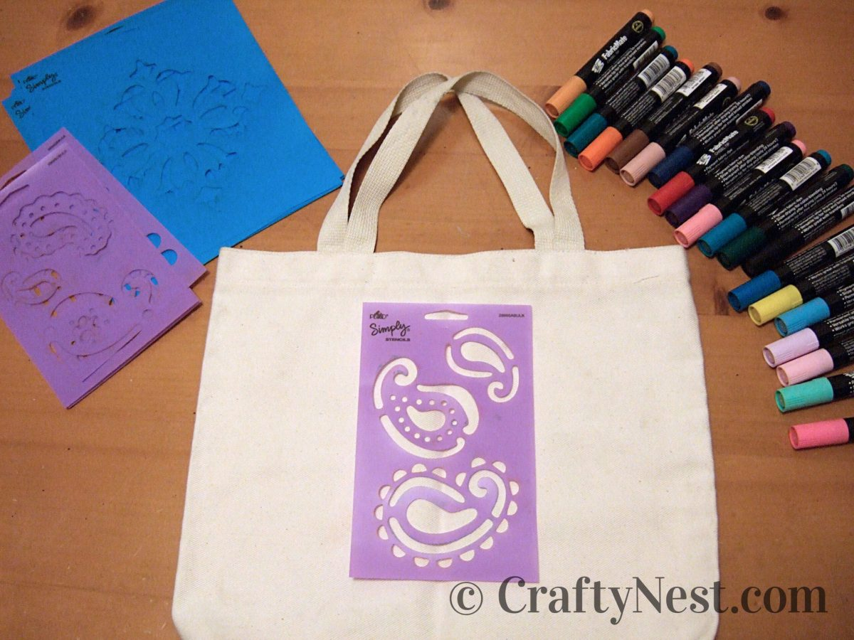Canvas tote bags, stencils, and fabric markers, photo
