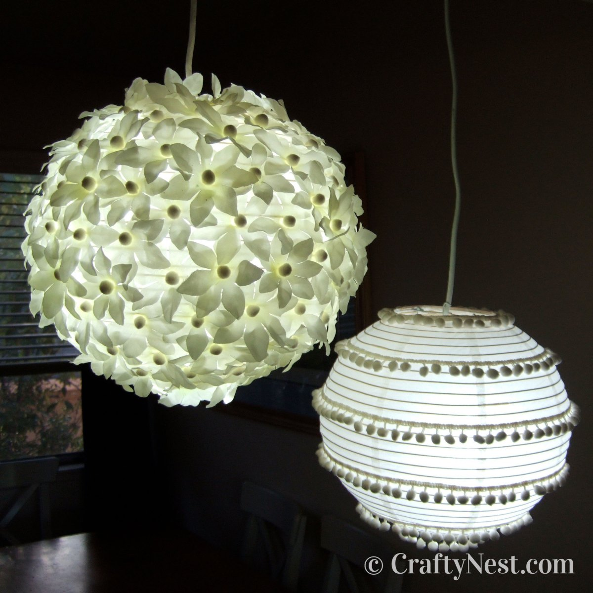 Two decorated paper lanterns at night, photo
