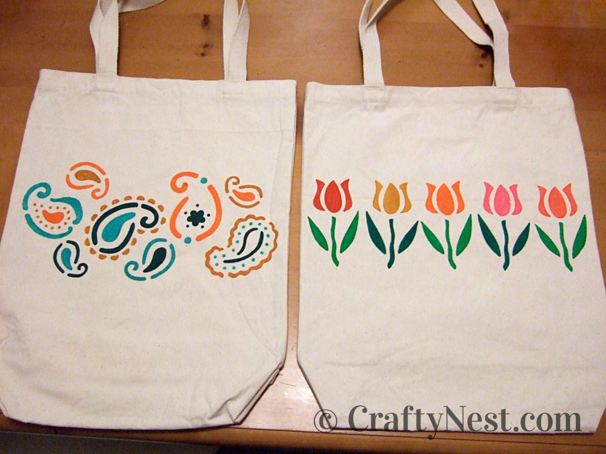 Canvas tote bags decorated with paisley and tulip designs, photo