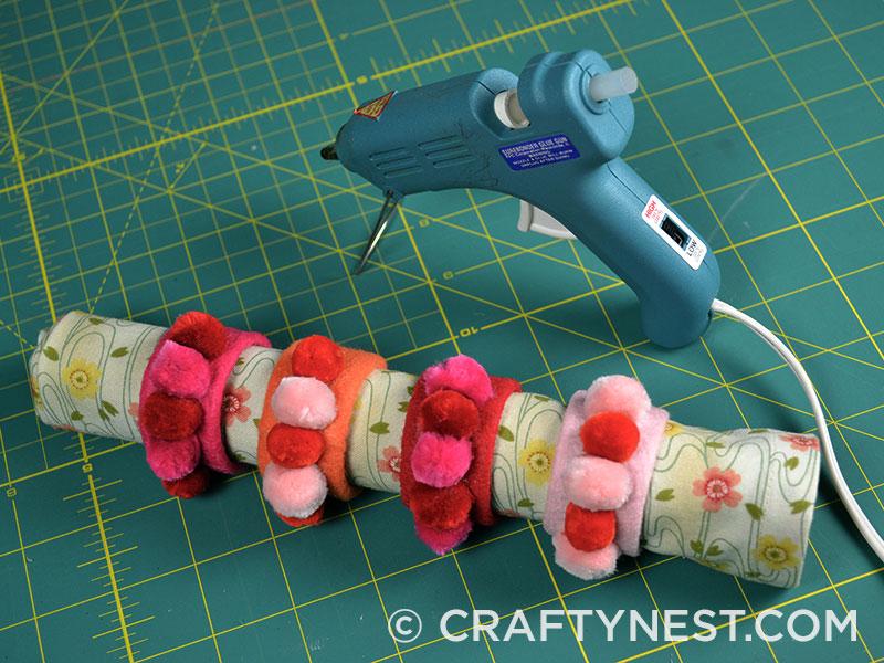 Glue pom poms to rings, photo