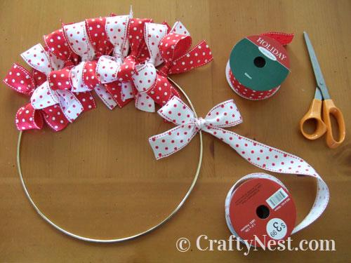 Tying ribbon bows onto the ring, photo