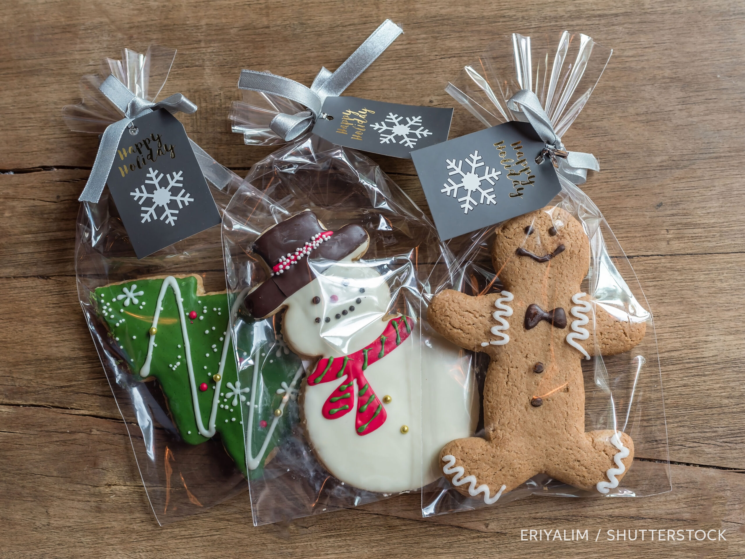 Frosted Christmas cookies in gift bags, photo