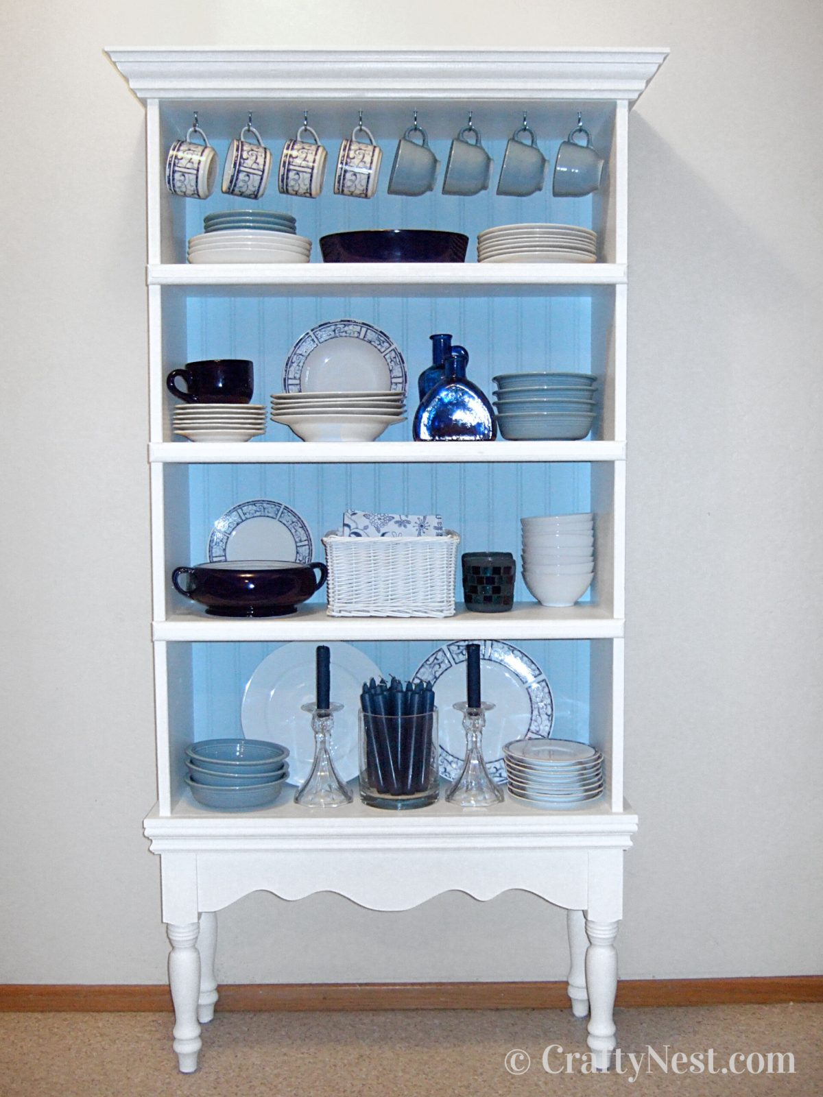 Fancy bookshelf with dishes, photo