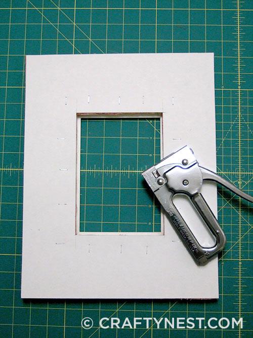 Staple cardboard to small frame, photo