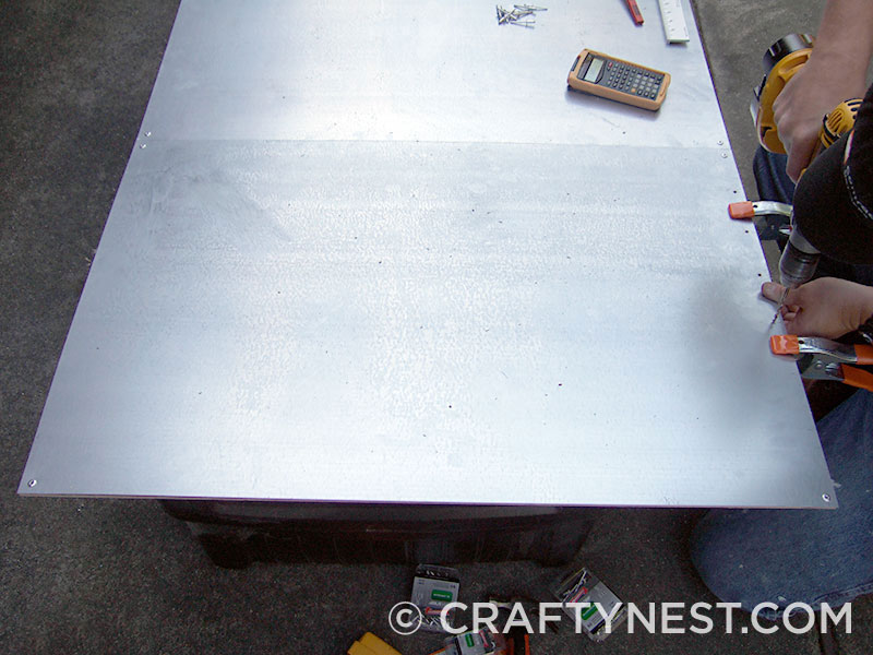 Lay sheet metal over plywood, photo
