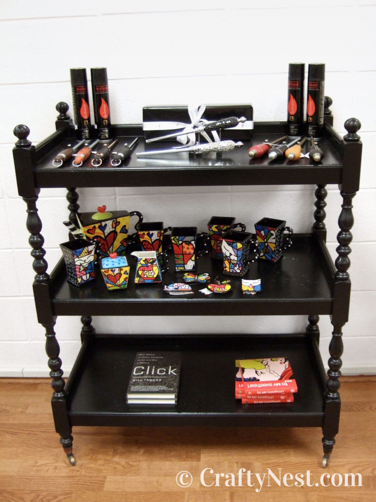 Black cart with things for sale, photo