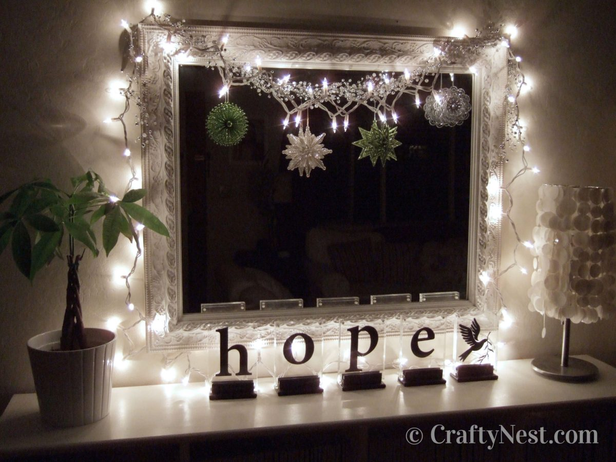 Lights, ornaments, and garland hanging on mirror, photo