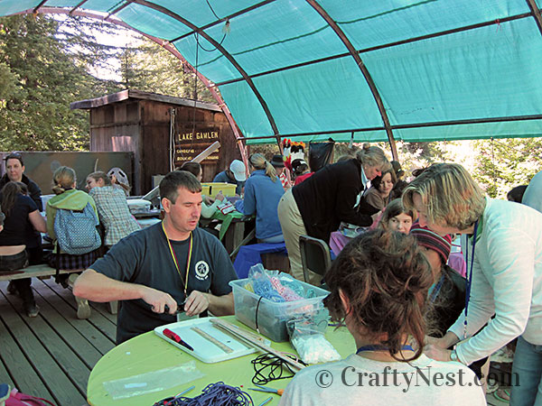 Campers and leaders making paracord braclets, photo