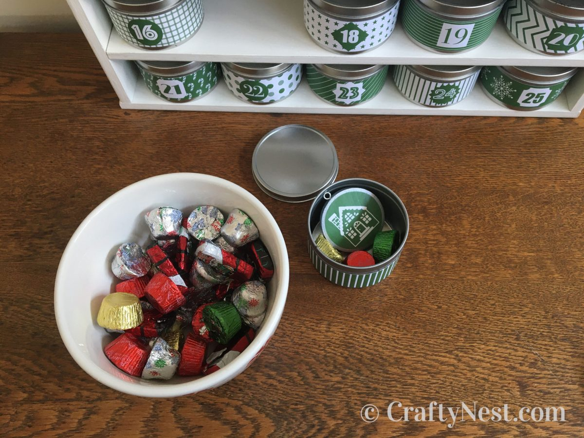 Candy and an ornament inside a tin, photo