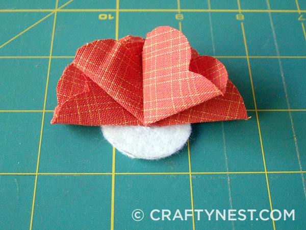 Fold and glue the third petal, photo