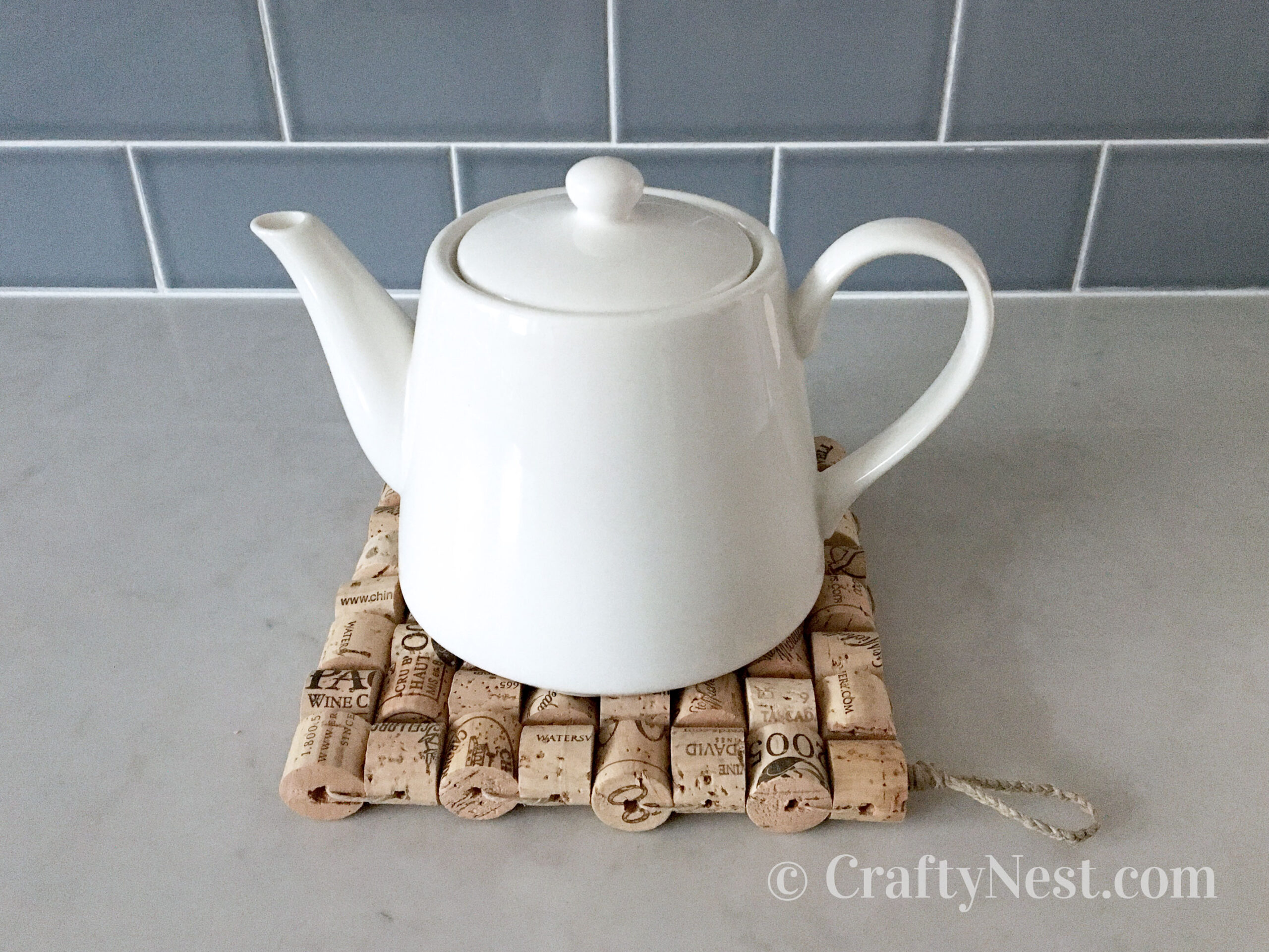 Teapot on a wine-cork trivet, photo