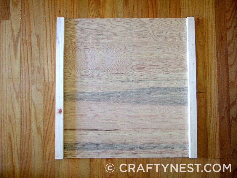 Attach 1x2s to back of plywood, photo