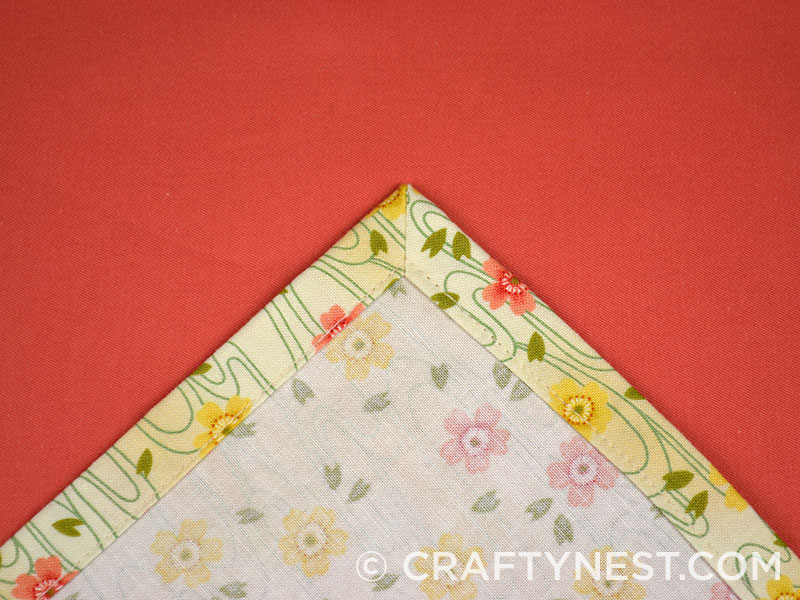 One mitered corner of a napkin, photo