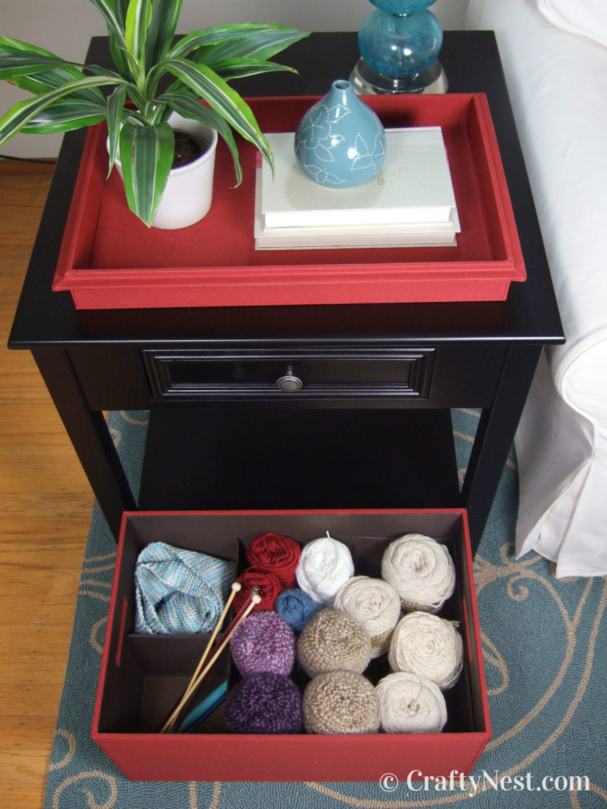 Open Bento Box and tray with knitting supplies, photo