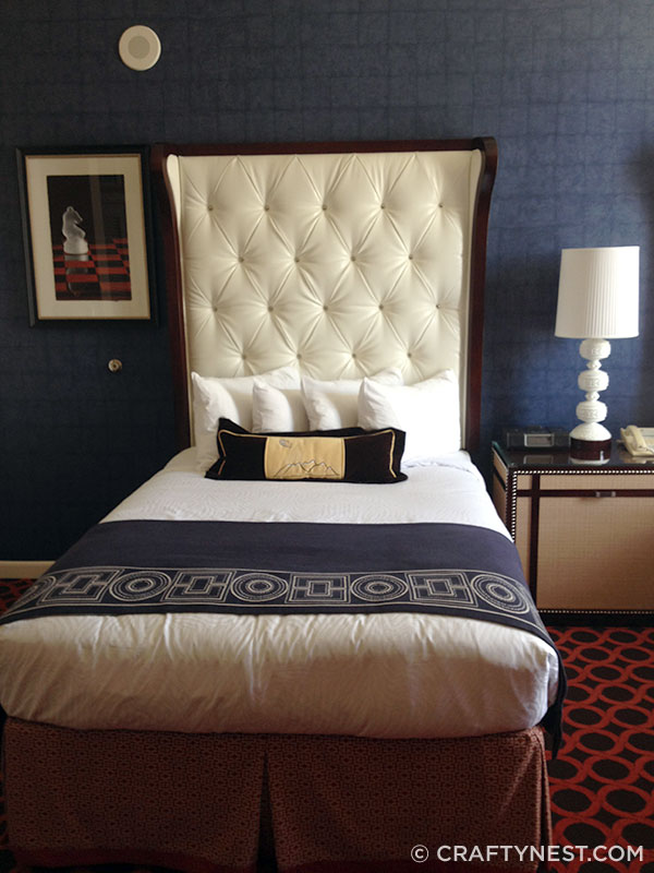 Bed with tall tufted headboard at Hotel Monaco, photo