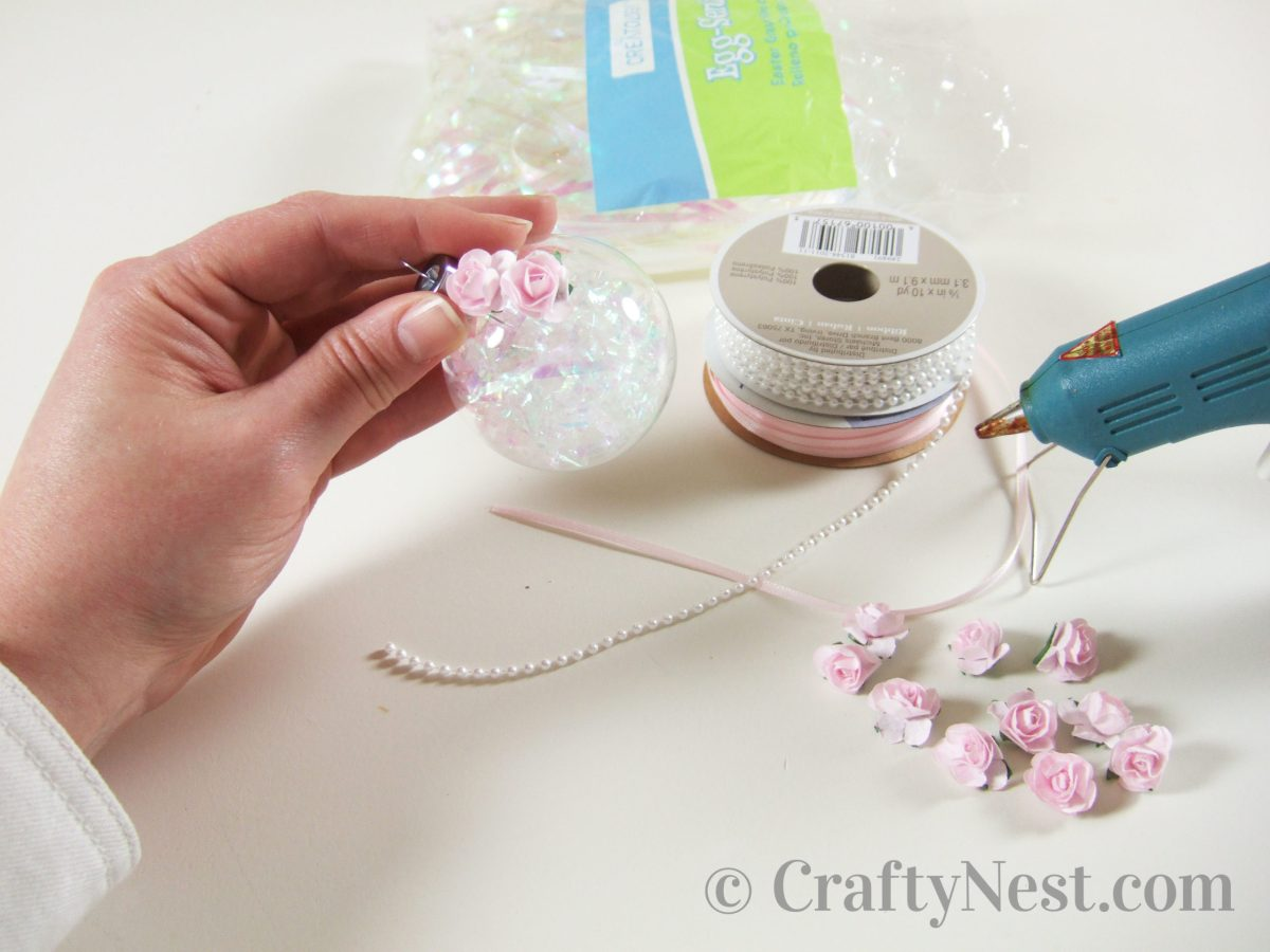Gluing flowers onto the ornaments, photo