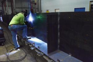 CraneWerks employee welding the inside of a box girder.
