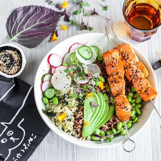 Japanese-style salmon skewers with mixed rice and wasabi pickled vegetables