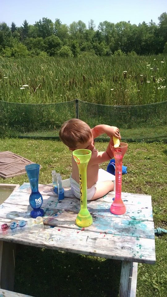 Playing With Water And Containers.